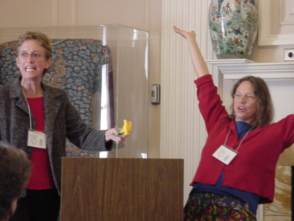 Outgoing SEMLA Chair Sarah Dorsey (r)celebrates as incoming Chair Diane Steinhaus adjourns the business meeting.